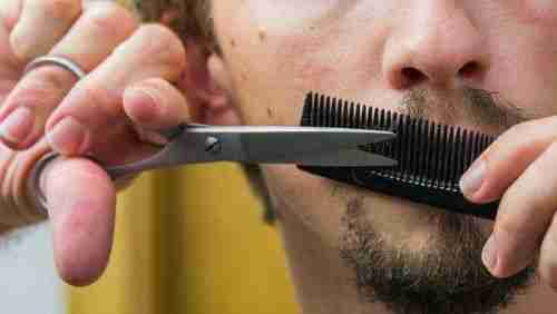 trimming with an electric mustache trimmer