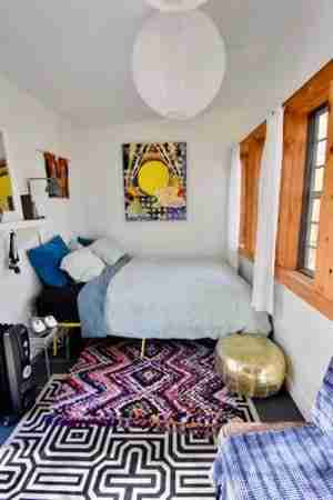 where to put the rug in a small bedroom